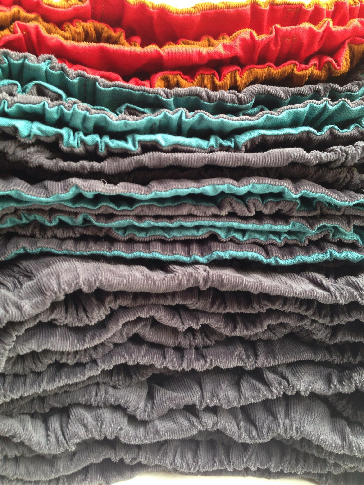 stack of corduroy skirts